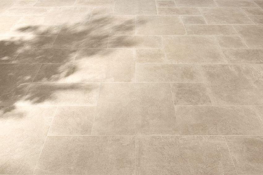 Dikte Natuursteen Tegels : Een terras met of zonder tegeldragers: wat is het verschil?